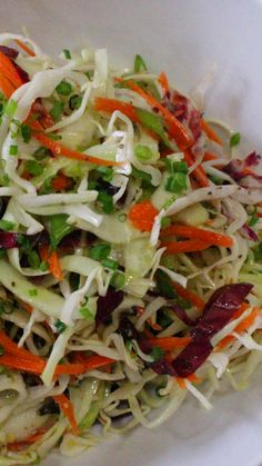 VINEGAR BASED COLESLAW - ½ thinly sliced head of green cabbage 1 cup of thinly sliced red cabbage 2 whole shredded carrots 3 thinly sliced green onions ¼ cup of apple cider vinegar 1 tablespoon of grainy mustard 1 tablespoon of honey or 1 teaspoon of sugar ¼ cup of olive oil 1½ teaspoons of celery seed Kosher salt and fresh cracked pepper to taste
