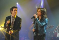 Pat Monahan of Train watches as Martina McBride takes the lead during their taping of <I>CMT Crossroads</I>. Patrick Monahan, Top Country Songs, Martina Mcbride, Sing To Me, New Music, Singing, Train, Watches, Band