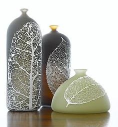 """Leaf Bottles"" by Nick Chase.  ""Chase's bottles are beautifully proportioned, and with their small tops provide excellent broad surfaces for his application of delicate but graphically strong patterns of leaves. Note the soft warm interior glow that warmly contrasts winter's frosty exterior imagery."" Michael Monroe"