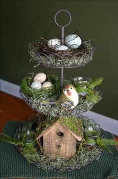 Cute spring centerpiece - 3 tiered wire with birdhouse, bird, nests, eggs, moss, etc. love the way the little nest/wreath fits in top tier - cute spring display! byme.kelly via MyStyleShare