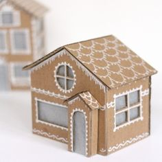 These Tiny Cardboard Gingerbread Houses are so easy to make and they even light up!