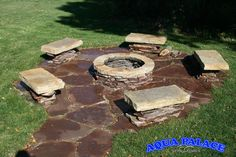 Hand made firepit and seating area next to pool.   Aqua Palace  810 Woodbury Ave  Council Bluffs, Iowa 51503  712-329-4180  www.aquapalace.com