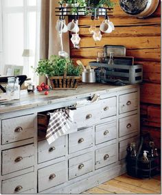 Reusing old pieces in your kitchen makes for a great one-of-a-kind space. I love the many drawers for super-organization!