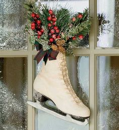 ice skate decoration I saw this done once with the whole pair and sat by a fireplace or hung from an old sled. Gorgeous! At any rate, won't use for a wreath (a cutting blade on the door? Seems like bad juju), but will decorate with it!