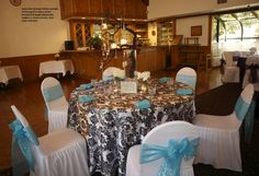 Swiss Park Banquet Center package B with full length damask tablecloth in black and white, chair cover in white, bow and napkin in aqua Banquet, Napkin, Aqua, Bow, Baby Shower, Table Decorations, Black And White, Park, Babyshower