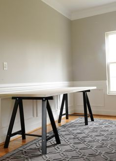 ikea legs + hollow core door? Lots of uses for old doors: temporary party tables, craft tables, work tops in basement with saw horses.