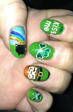 Detailed St. Patrick nail art with leprechaun and pot of gold.