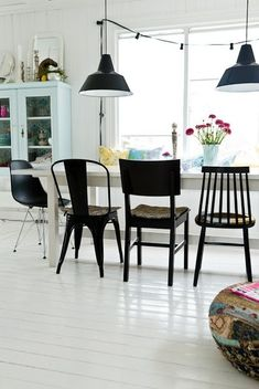 Paint your dining chairs for an instant update to your kitchen! This easy DIY will brighten your eating space in a snap. Painted chairs add an unexpected pop of color. For more kitchen styling and DIY ideas, go to Domino. Woven Dining Chairs, Mismatched Dining Chairs, Dining Room Chairs, Table And Chairs, Living Room Furniture, Dining Table, Office Chairs, Dining Set, Side Chairs