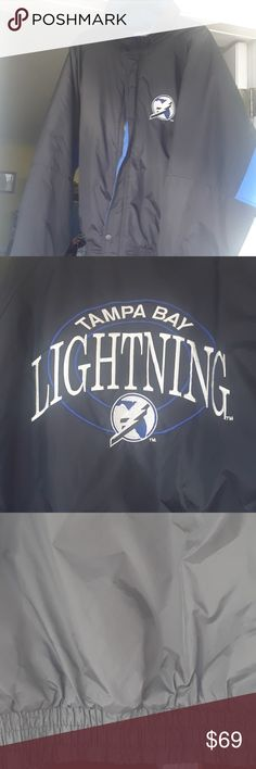 Tampa Bay Lightning Puffer Jacket Winter Tampa Bay Lightning Puffer Jacket Winter. No holes. Slight staining at collar, see last pic. NFL Official Product Jackets & Coats Puffers
