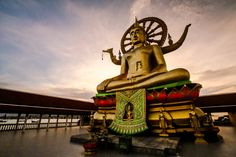 https://flic.kr/p/SjfBmF | Wat Phra Yai Sunset | This temple located in Ko Samui island in Thailand, is in fact a little island connected to Ko Samui Island thru a causeway.  This 12 meter hight Buddha statue is located in a really beatiful place and be able to experience the sunset in that location is a peaceful experience. Many thanks also to the monks that allowed us to visit this place.  IMG_4973-2