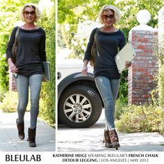 Katherine Heigl in a charcoal sweater.