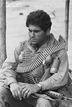 13 Mar 1968, Hue, South Vietnam --- Hue, South Vietnam: Close up of soldier with machine gun bandolier.