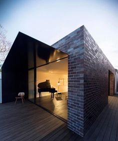 Once-derelict Marrickville cottage now a contrasting tones of light and dark house for two musicians - CAANdesign
