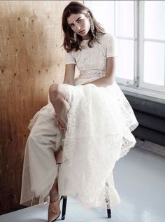 With a pretty lace design. | 36 Of The Most Effortlessly Beautiful Boho Wedding Dresses Ever