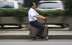 A man rides a home-made suitcase vehicle in #China. Our Editor's Choice photos. @shannon reuter
