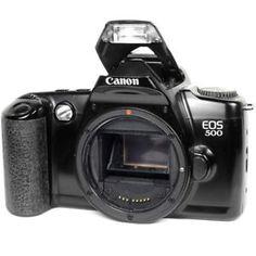 a camara slr canon eos 35mm de cine vintage 500 cuerpo negro con flash defectuoso