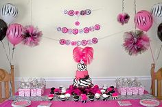 Now they make zebra marshmallows, they would be a perfect compliment to this party design. Another idea to take this design over the top, wrapping hot pink zebra duck tape around pvc pipe 2 make an inexpensive balloon arch, & attach zebra balloons all around & add  b-day banner across the top of the arch- attach arch 2 back legs of party table with zebra duck tape as well! & of course u have to add zebra socks 2 the party favor bag!! 2 tie everything 2gether add a zebra rug!! Happy Zebra Party!!