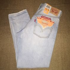 Levi's Light Wash Destroyed 501 Jeans - NWT! Brand new pair of Levi's classic 501 jeans! Tapered. Button fly. These are a must have in any closet if you love Levi's jeans. They are still new with tags! Levi's Jeans Ankle & Cropped