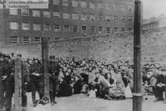 Suppression of the Warsaw Ghetto Uprising: Jews Forcibly Assembled Near the Wall of the Ghetto Await Deportation (May 1943)