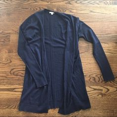 Gap Long Navy Blue Cardigan This Gap sweater is just one of those good essentials to have! The thick knitted stripe in the back is a unique feature that makes this sweater subtly stand out. It does have wool in it so a little itchy and because of that, there is a little bit of gathering/balling on the ends of the sleeves but only a little. Still is good condition! GAP Sweaters Cardigans