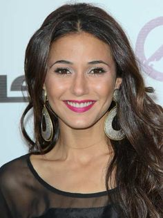 Use a wow shade to brighten up a simple outfit. #EmmanuelleChiriqui's fuchsia lip transformed her LBD.
