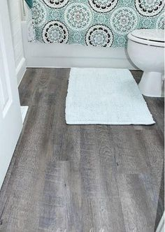 Just because you're tight on money doesn't mean that a bathroom floor makeover is impossible! Check out this tutorial on Applying Peel and Stick Floor Tiles if you are looking for a budget-friendly decoration option. Cheap Bathroom Flooring, Cheap Bathrooms, Bathroom Floor Tiles, Diy Flooring, Tile Floor, Stick On Tiles Bathroom, Linoleum Flooring, Stone Flooring, Wood
