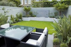 Garden Decor With Small Garden Design A Modern Design Garden Landscaping Design Equipped Four Seats Behind Home White Sofa And Glass Table Fenced Grass Gray Wall of Amazing Modern Garden Design To Beautify Your Lovely Home from Exterior Ideas Small Backyard Gardens, Garden Spaces, Small Gardens, Backyard Landscaping, Outdoor Gardens, Landscaping Ideas, Formal Gardens, Backyard Ideas, Modern Backyard