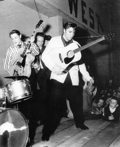 Scotty Moore and Elvis Presley on stage at the YMCA Gymnasium, Lexington, NC - Wednesday, March 21, 1956 (Thnx to Anthony King, admin  of the ELVIS PICTURES group on https://www.facebook.com/photo.php?fbid=1085529268136553&set=g.515244605238390&type=1&theater for this great photo.) See more: http://www.scottymoore.net/lexington.html