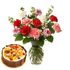 12 Red and pink carnation in vase with 1 kg fruit cake.