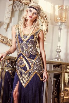Our Kismet Gown is one of our most luxurious Art Deco inspired creations. Using the iconic Art Deco sunray design, the gown is handbeaded on 100% sapphire bl...