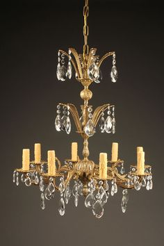 8 arm bronze and crystal chandelier, circa 1950. #antique #bronze #chandelier #crystal