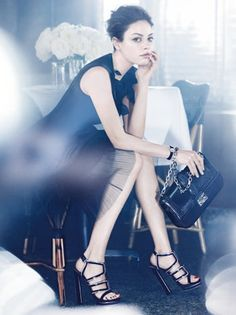 i absolutely love her and the dress and shoes. go dior.