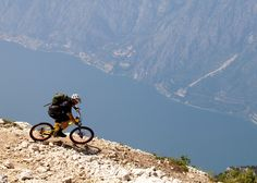 I hope that's a parachute on his back. Love biking epic trails.