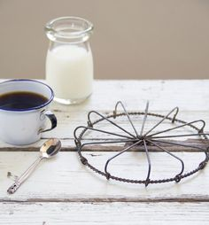 Would make a nice addition to the kitchen - antique wire trivet by cottagefarm on Etsy,