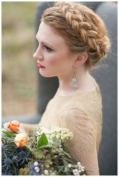 Scottish highlands wedding inspiration. Beautiful bride with braided hair. Bouquet with tulips, pheasant feathers and thistle by Gertie Mae's Floral Studio. Hair and makeup by Beauty Asylum. Image by Shauna Veasey Photography.