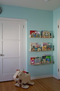 Elsa's Adorable Blue Nursery Nursery Tour | Apartment Therapy > Cute Idea: bookshelves made from Ikea spice racks.