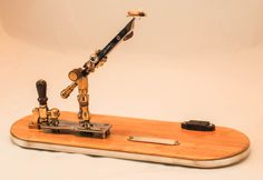 Bamboo base, laminated to aluminum. Walnut, brass and silver components. Ball style vise with 360 degree rotation of the jaws. The jaws are cam operated. Fly Tying Vises, Bamboo Fly Rod, Fly Rods, Wood And Metal, Fly Fishing, Brass, Tools, Silver, Style