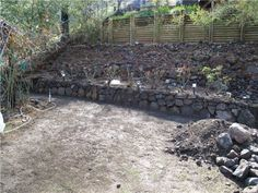 How to Build a Dry Stack Retaining Rock Wall: 9 steps