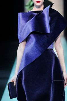 We can't get over these incredible sculpted silhouettes from the #Emporio @ARMANI Official show, did you see them?!