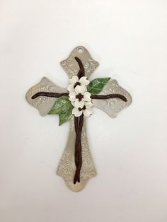 A personal favorite from my Etsy shop https://www.etsy.com/listing/489363723/handmade-pottery-cross-dogwood-flower