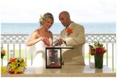 These days many couples include a Blending of the Sands Ritual ( sometimes called a Unity Sand Ceremony)  which symbolises the blending of two lives together. This lovely frame holds the sand and  provides a colourful reminder of the wedding.
