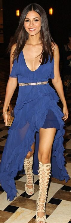 Who made Victoria Justice's tan gladiator sandals, gold clutch handbag, and blue ruffle gown?