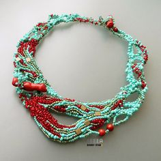 Coral Reef freeform beadwoven and embroidered necklace by Leela. Sponge coral beads, branch coral sticks, seed beads, Miyuki Tila beads, Ultrasuede