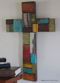 I knew I saved all of those little scraps I have cut from other colorful wood projects for a reason.       I made a cross out of pallet wood...