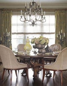 Barry Dixon design with naturalistic textures and shapes. Niermann Weeks Avignon chandelier; Swaim dining chairs in Bergamo's Siegfried fabric; Barcelona table by Panache Designs.