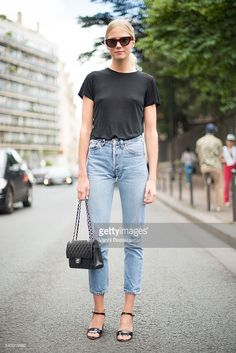 Michaela Thomsen poses wearing Levis jeans and Chanel bag after the Etudes show during Paris Menswear Fashion Week SS17 on June 25, 2016 in Paris, France.