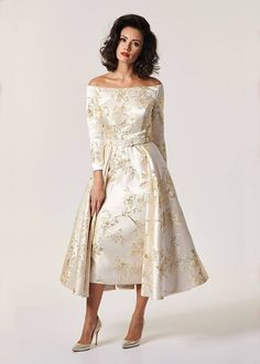 Refined champagne and gold brocade off the shoulder inspired couture gown. An elegantly designed full skirt over a pencil skirt, pure glamour. Mother Of The Bride Fashion, Mother Of Bride Outfits, Mother Of Groom Dresses, Mothers Dresses, Occasion Wear Dresses, Wedding Outfits For Groom, Brocade Dresses, Mob Dresses, Full Circle Skirts