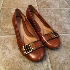 Cognac buckle Nurture flats These flats are not only stylish with their buckles but it truly feels like walking on pillows. These are super cushioned and only worn twice. Soles are in amazing condition. Shoes are in perfect condition and look brand new. Make a reasonable offer. Thanks for looking  Shoes Flats & Loafers