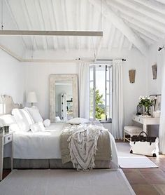Love this clean, white bedroom
