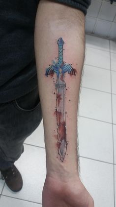 First tattoo! Watercolor Master Sword by Mauricio Aquino @ Verani tattoo in Porto Alegre Brazil.